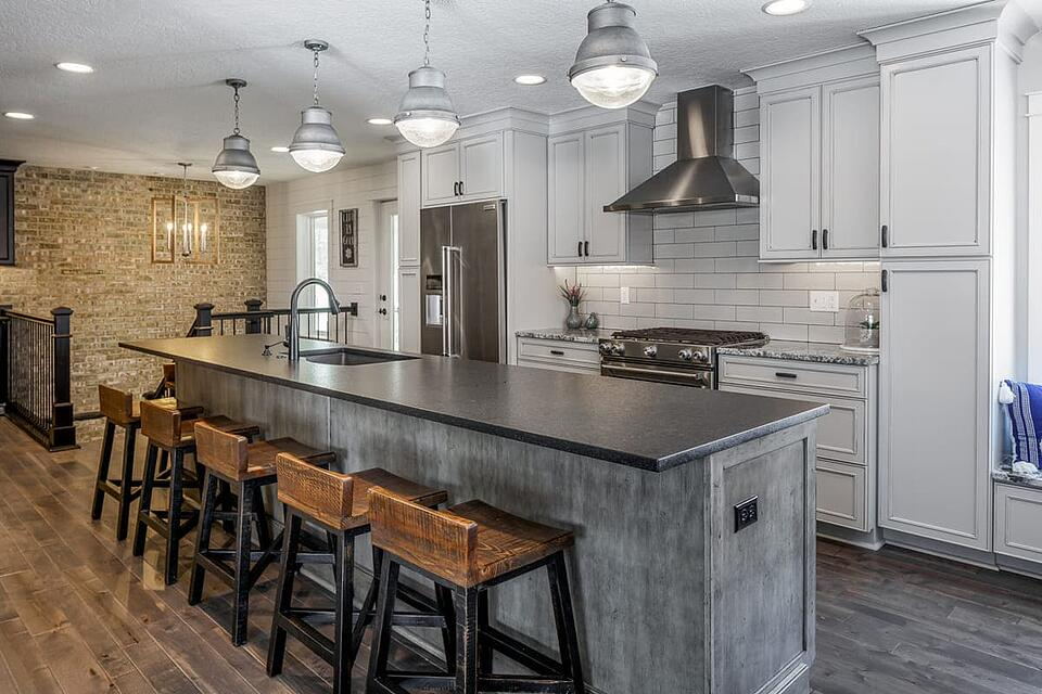 Kitchen Remodel with Large Eat-In Island and Subway Tile and Stone Accent Wall | Compelling Homes