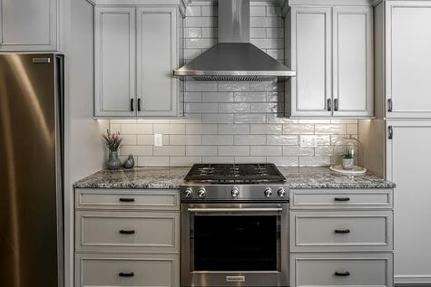 Kitchen Remodel with Subway Tile and Granite Countertops Modern Drawer Pulls Custom Cabinetry around Hood Vent | Compelling Homes