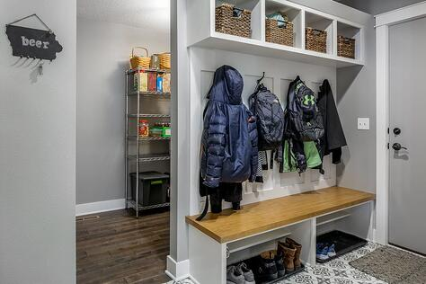 Whole Home Remodel Custom Mudroom and Pantry Area Behind Sliding Barn Door Custom Built-Ins | Compelling Homes