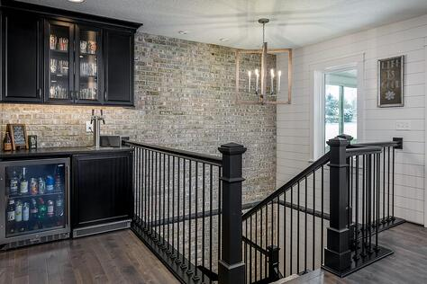 Whole Home Remodel with Stone Accent Wall and Walk-Up Bar and Shiplap Wall | Compelling Homes
