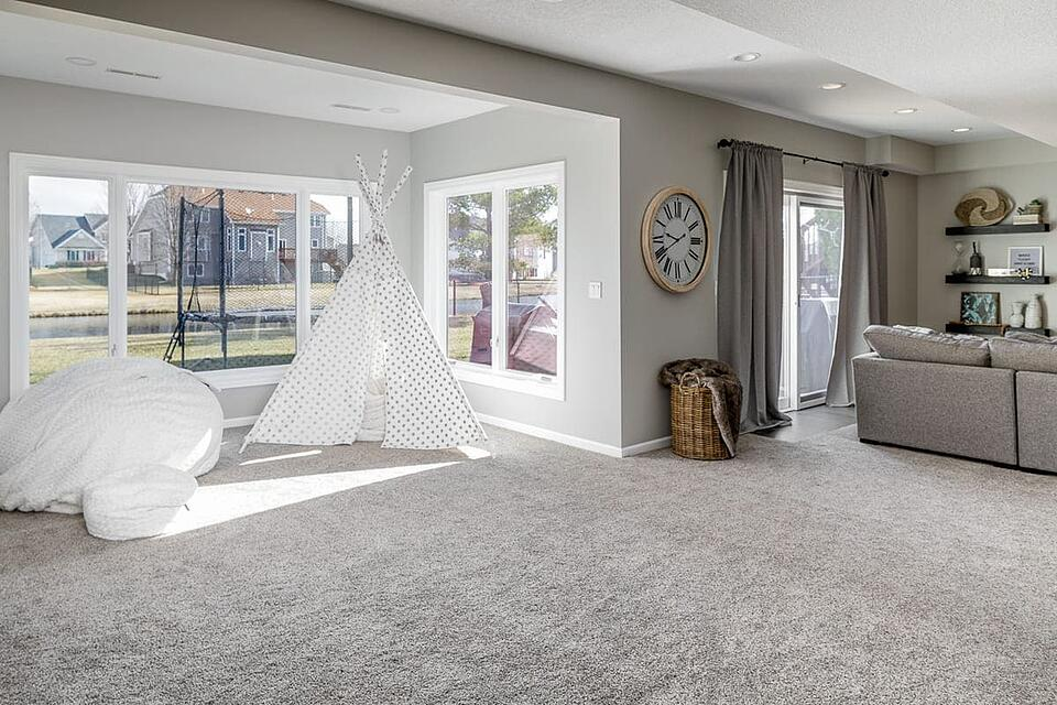 Basement Remodel with Play Area Overlooking Backyard Sliding Doors | Compelling Homes Remodeling & Design