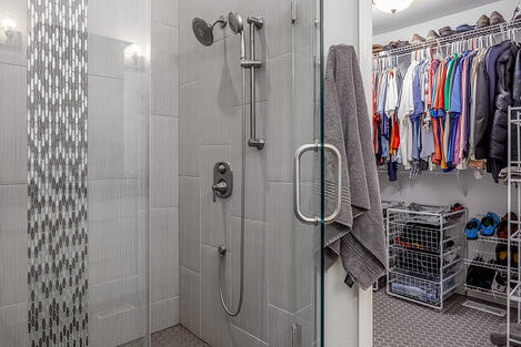 Bathroom Remodel Walk-In Glass and Tile Shower Entering into Walk-In Closet