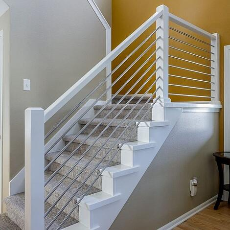 Full-Home Remodel Yellow Accent Wall with Modern Conduit Railing