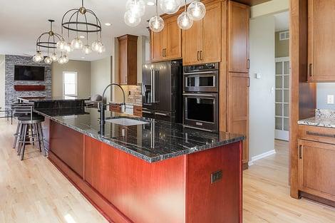 Home Remodel Open Floor Plan with Eat-In Island and Hidden Cabinet Door to Hallway