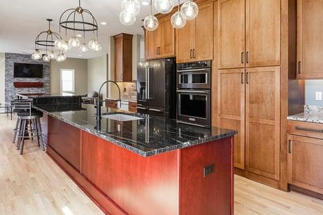 Home Remodel Open Floor Plan with Eat-In Island and Hidden Cabinet Door