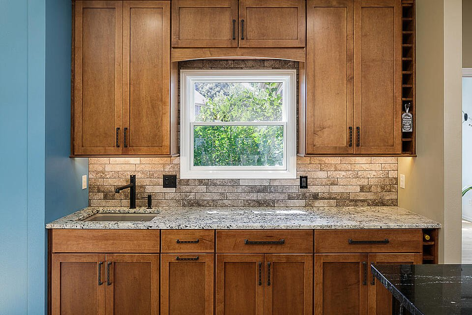 Kitchen Remodel Wooden Cabinets Stone Countertop and Backsplash