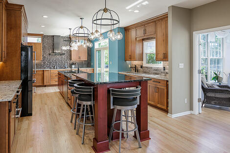 Kitchen Remodel with Eat-In Island and French Doors to Patio