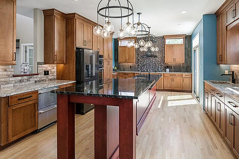 Windows Built Into Kitchen Cabinet Design by Compelling Homes in Des Moines