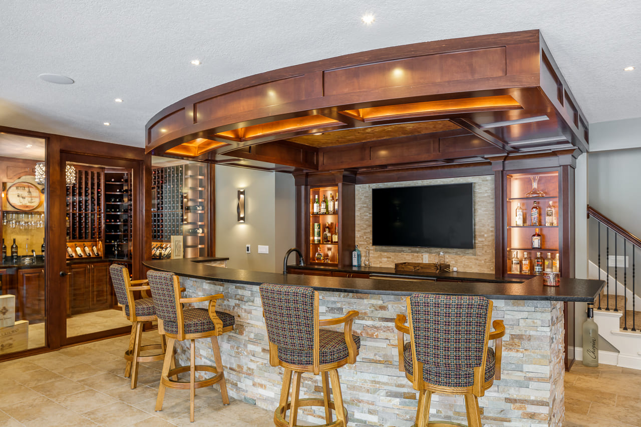 Custom Bar with Wine Cellar in Walk Out Basement with Natural Light | Compelling Homes Des Moines, IA