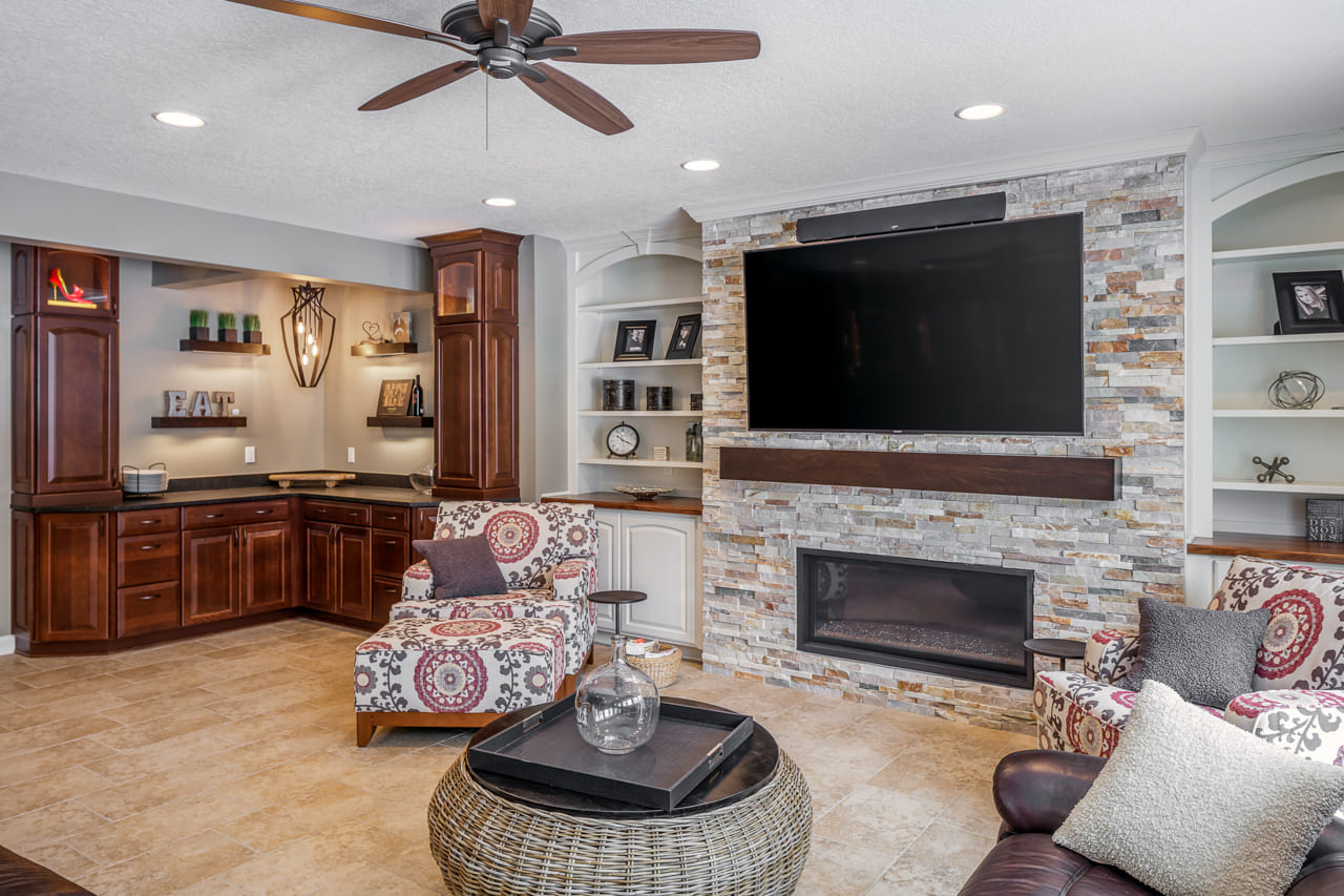 Custom Buffet Area and Living Room with Stone Accent Wall and Custom Built Ins | Compelling Homes Des Moines, IA
