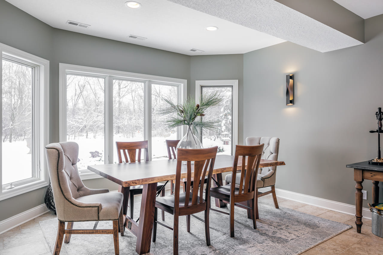 Dining Area in Walk Out Basement With Large Windows and Natural Light Featuring Heated Radiant Flooring | Compelling Homes Des Moines, IA