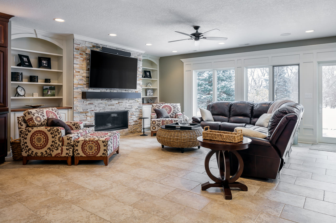 Elegant Walk Out Basement with Stone TV Wall and Heated Flooring | Compelling Homes Des Moines, IA