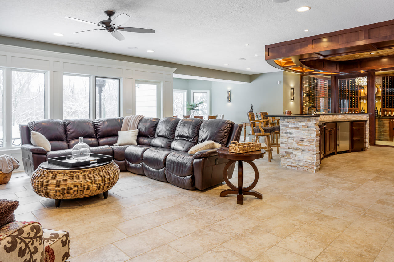 Elegant Walk Out Basement with Wine Cellar and Custom Bar with Natural Light | Compelling Homes Des Moines, IA