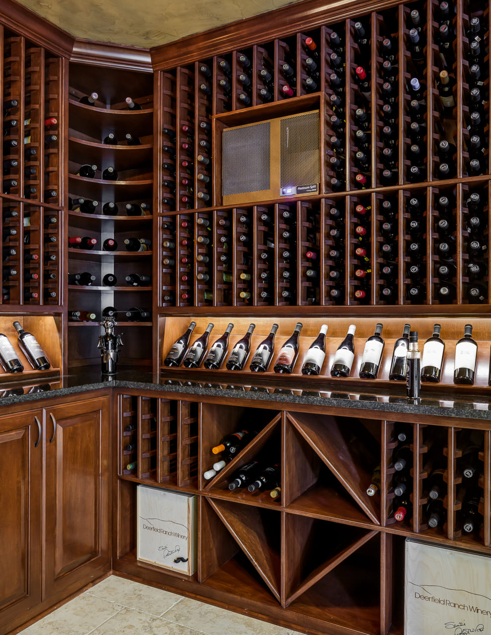 In-Home Wine Cellar with Custom Shelving in Walk Out Basement Remodel | Compelling Homes Des Moines, IA