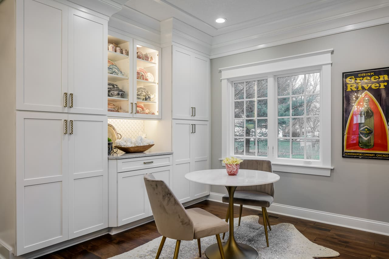 Beautiful Sitting Area Off of Kitchen Remodel with Built In Cabinet Storage and Handmade Custom Crown Molding Accents | Compelling Homes Design-Build Experts in Des Moines, IA